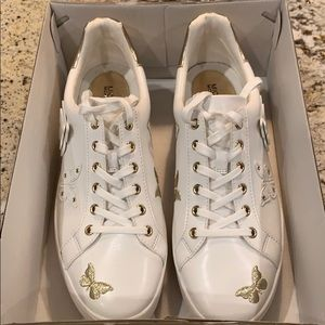 Michael Kors white/gold butterfly trainers
